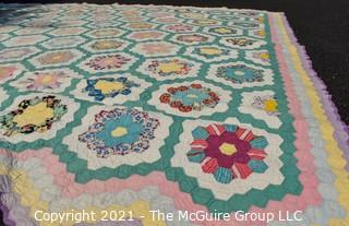 Vintage Hand Made Quilt in the Grandmother's Flower Garden Pattern Made by Elizabeth Rockwell circa 1930's.  Documented and listed in the West Virginia Heritage Quilt Search. Some Wear due to age.