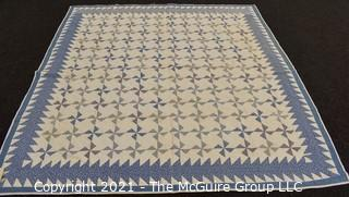 """Vintage Hand Made Quilt Signed by Isabella Young in the Pinwheel Pattern in Blue & White.  Some Wear due to age. Measures 72"""" x 75""""."""