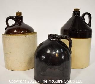 Collection Of Three (3) Primitive Antique Stoneware Utilitarian Crocks or Jugs with Brown Albany Slip Tops. Two Jugs Have Original Corked Tops.