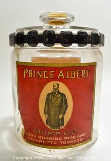 """Antique Glass Prince Albert Tobacco Jar or Humidor with Back Label and Metal Locking Strap Around The Lid. Measure 7"""" T"""