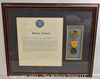 Meritorious Service Citation and Medal Presented to William Caldwell, signed by Dick Cheney, Secretary of Defense; framed under glass.