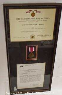 Presidential Meritorious Service Medal Presented to William Caldwell, First Lieutenant, U.S. Marine Corp; framed under glass.