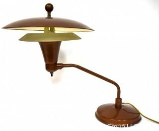 """Mid Century Swiveling Table Lamp with Tiered Metal Saucer Shade. Measures 17"""" tall."""