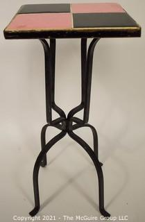 """Vintage Wrought Iron Table with Pink and Black Tile Insert. Measures 19"""" tall and and 9"""" square."""