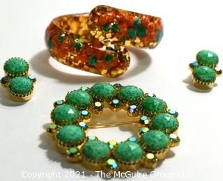 Group of Mid Century Vintage Jewelry.  Includes faceted Rhinestone Circle Brooch with Matching Clip On Earrings and Lucite Hinged Cuff Bracelet with Gold Confetti Glitter.