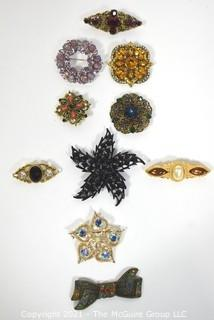 Group of Vintage Rhinestone Brooches. Includes Trifari.
