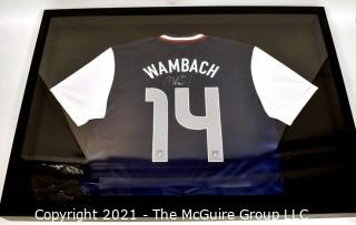 Framed and Professionally Mounted Signed Abby Wambach Team USA Women's Soccer Olympic Jersey.  Signed in Black Sharpie with her U.S. Olympic Team #20