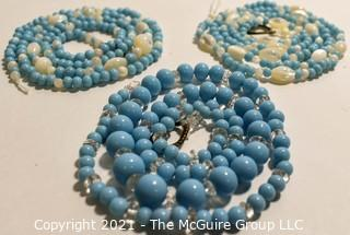 Three (3) Strands of Blue Glass and Mother of Pearl Beads.