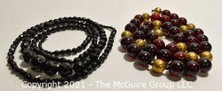 Two (2) Strands of Beads. One made of French Jet and the other lucite.