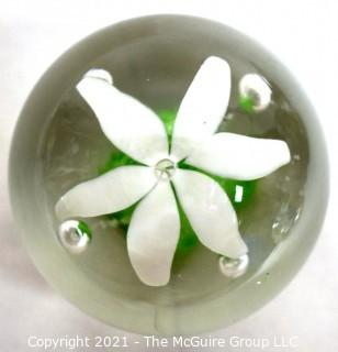 """Vintage Round Hand Blown Lampwork Glass Paperweight with White & Green Flower. Measures 3"""" in diameter."""