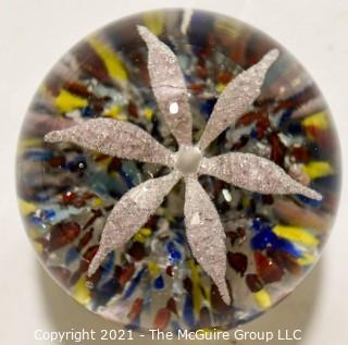 """Vintage Round Hand Blown Lampwork Glass Paperweight with White Flower. Measures 3"""" in diameter."""