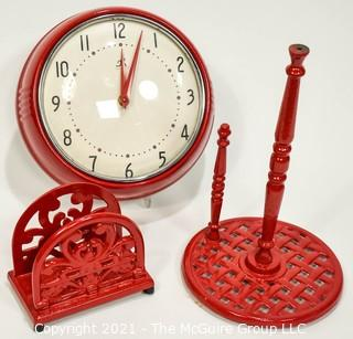 Three (3) Red Kitchen Items Including Wall Clock, Paper Towel Dispenser and Napkin Holder.