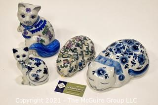 Four (4) Blue and White Painted Porcelain Cats Figurines.