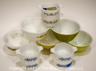 Group of Vintage Pyrex Mixing Bowls and Casserole Dishes in Avacado Green and Blue Flowers.