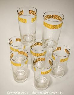 Set of Seven (7) Vintage Clear Glass Tumblers with Gold Trim.