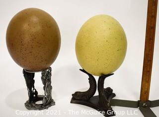 TWo (2) Faux Decorative Ostrich Eggs on Stands.