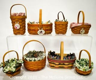 Collection of (8) Longaberger Baskets with Fabric Liners.