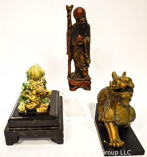 Three (3) Asian Statues Including Ceramic & Metal Foo Dog & Carved Elder.