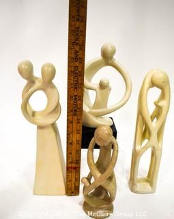 Four (4) Hand Carved Soapstone Sculptures of People Embracing