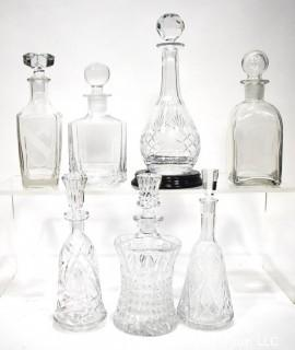 Seven (7) Clear Glass & Crystal Bar Liquor Decanters with Stoppers