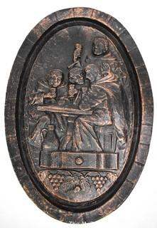 """Heavy Cast Iron Oval Plaque of Monks in the Wine Cellar. 18"""" x 12""""."""