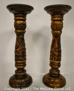 Pair of Carved Wooden Candle Sticks.
