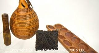 Four (4) Carved Wooden Items Including Batik Press, Mancala Games, Gourd and Mallet