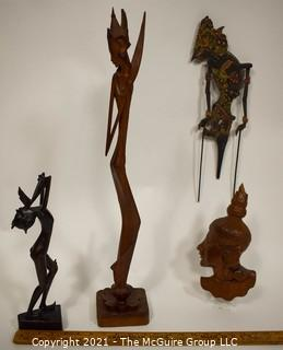Four (4) Ethnographic Carved Women.