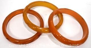 Set of Three (3) Carved Bakelite Bangle Bracelets in Butterscotch