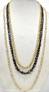 Three (3) Opera Length Fresh Water Pearl Necklaces Including One with Grey Coin Pearls.