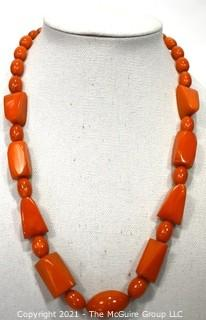 """Mid Century Bakelite Art Deco Butterscotch Amber Bead Necklace in Geometric Shapes.  Measures 24"""" long."""