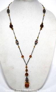 Vintage Art Deco Hand Blown Amber & Black Glass Drop Bead Necklace on Metal Chain with Pendant Center.