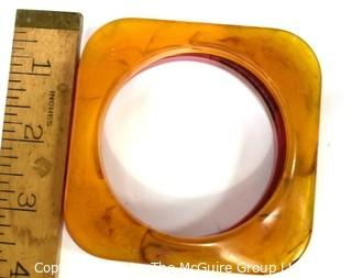 Pair of Vintage Bakelite Square Bangle Bracelets in Butterscotch Apple Juice and Pink .