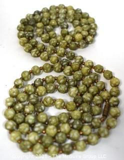 """Vintage Opera Length Green & White Mottled Textured Beads with Screw Claps.  Measures 52"""" long."""