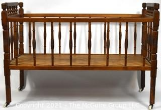 """Antique Mahoghany Spindle Baby Bed.  Measures 36"""" x 19"""" x 25"""""""