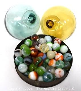 Two (2) Hand Blown Glass Fishing Net Floats and Group of Vintage Marbles.