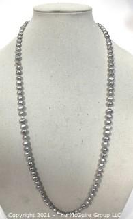 """Opera Length Grey Freshwater Coin Pearl Necklace with 14k Gold Clasp.  Measures 32"""" long."""