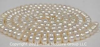 "Strand of White Potato Round Freshwater Pearls.  Measures 48"" long."