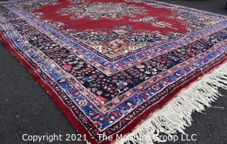 """Hand Woven Persian Wool Rug with Medallion Center on Red Ground with Blue Border. Some wear.   Measures 115"""" x 155"""""""