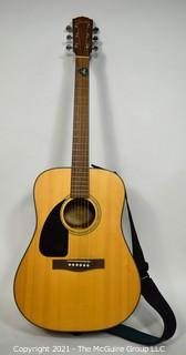 Fender CD100LH Acoustic Guitar in Natural Finish with Padded Soft Case.