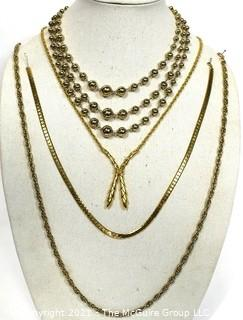Four Pieces of Gold Tone Costume Jewelry Necklaces.
