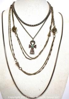 Four Pieces of Silver Tone Costume Jewelry Necklaces.