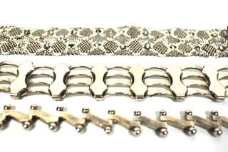Three Silver Tone Bracelets Including One Made of Woven Glass Seed Beads.