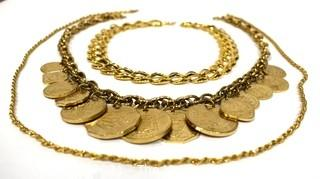 Three Chunky Gold Tone Necklaces Including One With Coins.