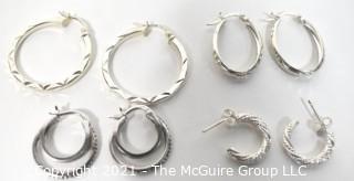 Four Pairs of Sterling Silver Pierced Hoop Earrings.