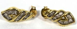 10 kt Gold with Clear Stone Earrings. Weighs 2.3 g.