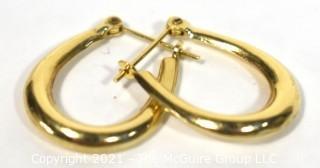 Pair of 14 kt Gold Hoop Pierced Earrings. Weighs 1.6 g