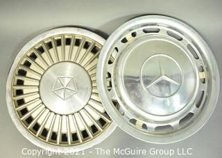 Two (2) Vintage Car Hubcaps for Chrysler and Mercedes.