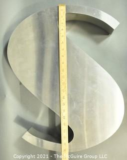"""Large Art Deco Metal Sign Letter """"S"""" with Neon Light.  It has been lighted from the back with wall mounts that raise it off the wall.  Bulb has been broken in one place. Measures approximately 22"""" long and 19"""" wide & 4"""" Deep."""