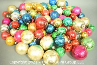 Vintage Mercury Glass Ball Ornaments in Various Colors and Sizes.